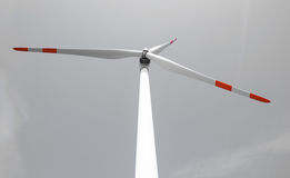 Single wind turbine. Produces green clean energy Royalty Free Stock Image