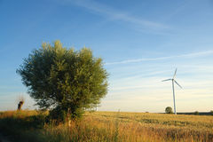 Single wind turbine, rural landscape. Royalty Free Stock Photography