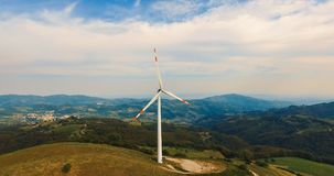 Single wind turbine. Single wind turbine on the green hill Royalty Free Stock Photography