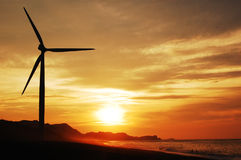 Single wind turbine at sunse Stock Photos