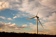 Single wind turbine at sunset Stock Photos