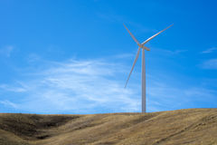 Single wind turbine on top of a hill. With blue sky Royalty Free Stock Photos