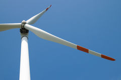 Single wind turbine. White red single wind turbine detail Stock Photography