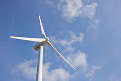 Single windmill for renewable electric energy production. On blue sky Stock Image