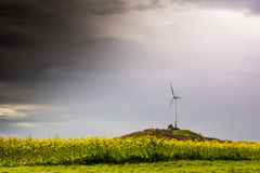 Single Windmill Turbine Hill Flowers Yellow Driving Highway Moti. On Blur Landscape Overcast Weather Sustainable Energy Germany Europe Green Clouds Heavy Royalty Free Stock Image