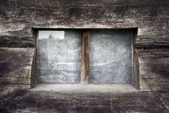 Single window on aged wooden wall. Abstract textured decorative backgrounds. Details for design Royalty Free Stock Photography