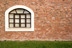 Single window in a brick wall Stock Images