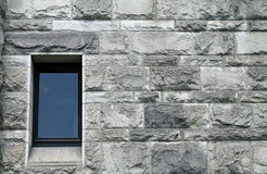 Single Window in a Gray Stone Wall Royalty Free Stock Image