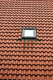 Single window on red roof Stock Photography