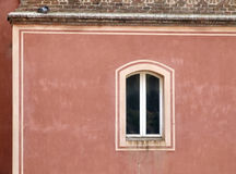 Single window on a red wall Royalty Free Stock Image