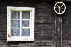Single window and the wheel. View of single window and small wheel of cart in one shot Royalty Free Stock Photo