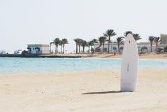 Single windsurfing board in a sand Stock Photos