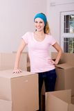 Single woman. Young single woman moving to new home stock photography