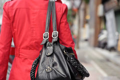 Single woman. Holding bag and walking in street, closeup portrait of shallow DOF stock photo