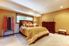 Single woman asian master bedroom interior with yellow walls. Royalty Free Stock Photo