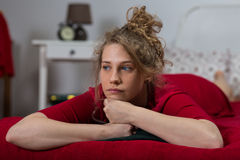 Single woman in bed Stock Photography