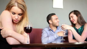 Single woman being envious at happy couple Stock Photos