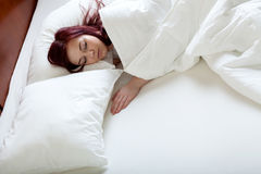 Single woman in big bed. Single woman sleeping alone in big bed stock photography
