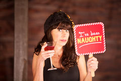 Single woman caught being naughty Royalty Free Stock Photography