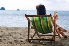 Single woman in chair Stock Photo