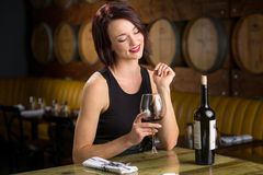 Single woman on a date with wine glass flirting at restaurant winery stock images