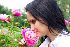 Single woman with flower Stock Photo