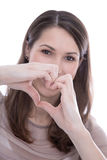 Single woman making a heart with her hands. Royalty Free Stock Photos