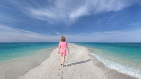 Single woman on open empty long shore as spirituality concept Stock Image
