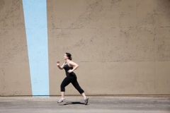 Single woman runs to get in shape Royalty Free Stock Photo