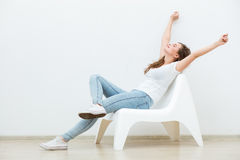 Single woman sitting on white chair Royalty Free Stock Image
