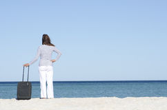 Single woman waiting with case at seaside Royalty Free Stock Image
