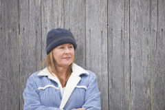 Single woman warm jacket and bonnet Stock Photos