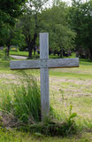 Single wood cross in a cemetery Stock Images