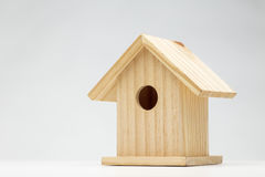Single wooden bird house Stock Images