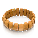 Single wooden bracelet over white Royalty Free Stock Photo