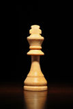Single wooden chess piece Stock Photo