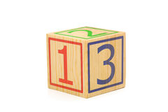 Single wooden cube with numbers one, two and three imprinted - e. Single wooden cube with numbers one, two and three imprinted over white background - education Royalty Free Stock Image