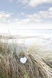 Single wooden heart on beach dunes Royalty Free Stock Image