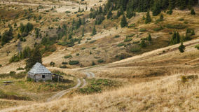 Single wooden house on slope meadow in Carpathian mountains. Single wooden house on slope meadow in Carpathian mountains Royalty Free Stock Images