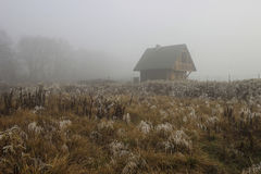 Single wooden hut on misty morning Stock Images