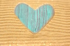 Single wooden love heart in the sand Royalty Free Stock Images