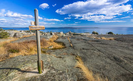 Single wooden sign on Swedish coast Stock Photo
