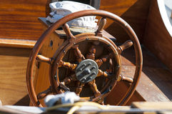 Single wooden steering wheel Stock Images