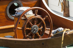 Single wooden steering wheel Royalty Free Stock Photo