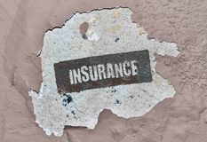 Single word Insurance. Word Insurance written on a damaged wall Royalty Free Stock Images