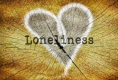 Single word Loneliness. Word Loneliness written over drawn broken heart Royalty Free Stock Photo