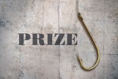 Single word Prize. Word Prize and fishing hook on vintage background stock image