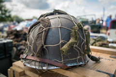 A single WWII helmet on a wooden box. Stock Photography