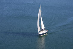 Single yacht on blue sea Stock Photos