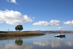Single Yacht Moored off the Banks of Midmar Dam Royalty Free Stock Image